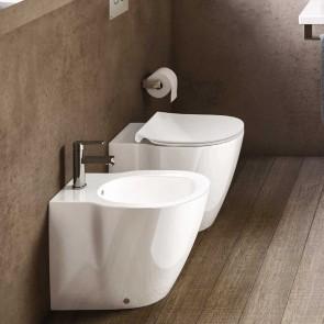Ambiente inodoro y bidé a suelo para cisterna empotrada CONNECT con asiento tapa normal de Ideal Standard